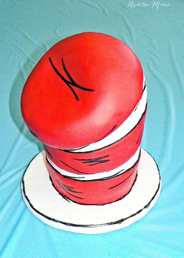 a carved hat in the cat cake, draw with an edible black marker to make it look like the drawings of the hat
