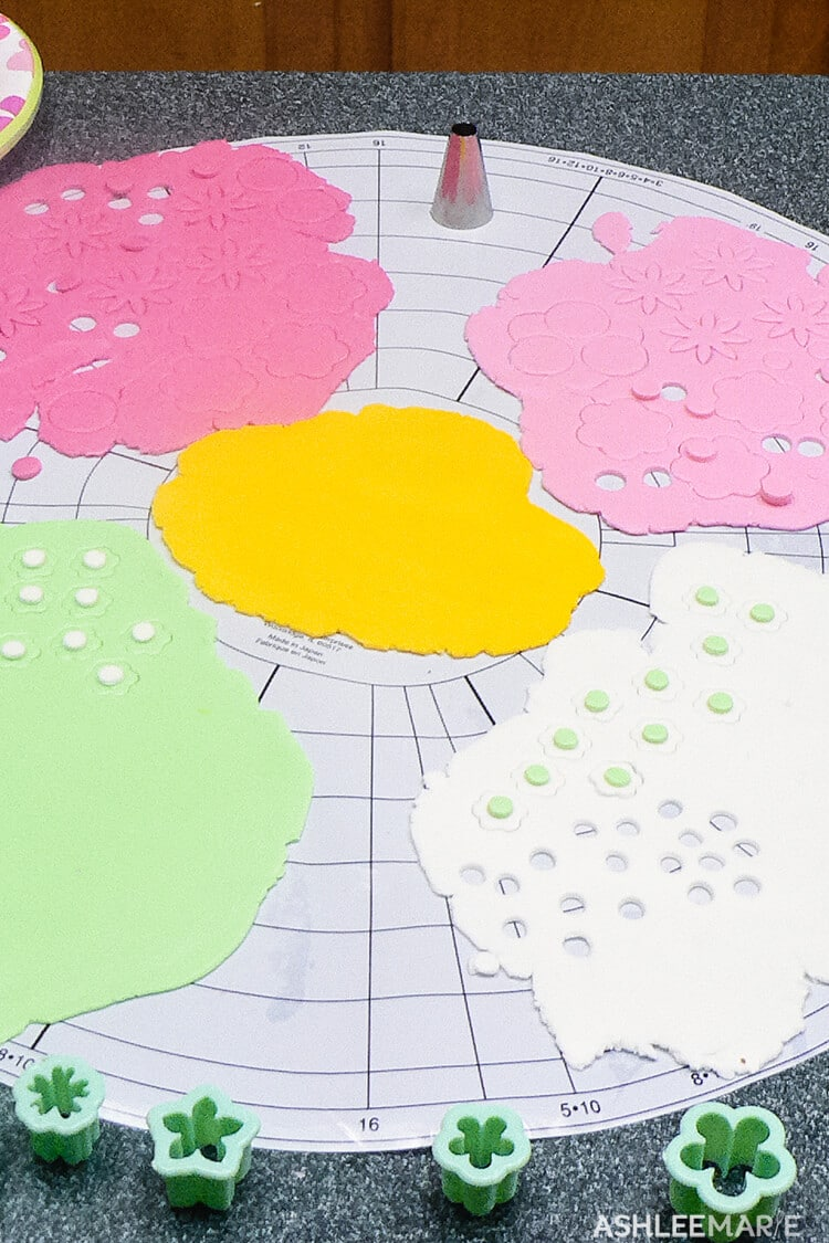 colored fondant flowers for topsy turvy cake