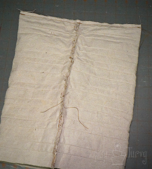 painters drop cloth stripped triangle pillow sewing together