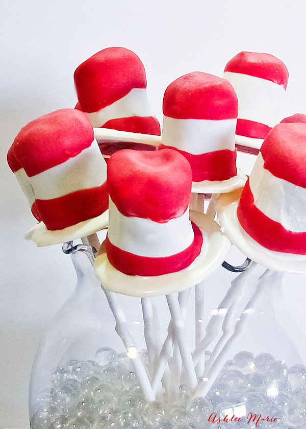 you can make these cat in the hat pops made of cake pops or oreo cookie pops