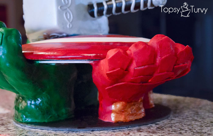 avengers-carved-birthday-cake-iron-man-gloves-stand