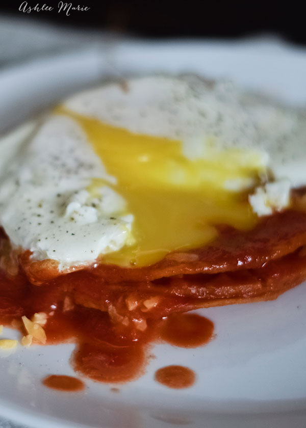 an easy and delicious classic mexican dish, stacked tomato enchilada's with a fried egg