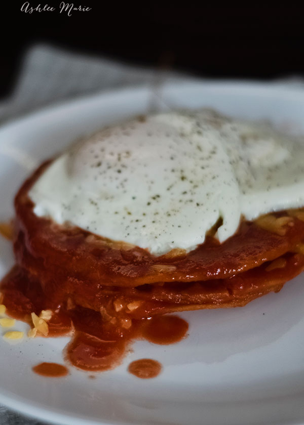stacked tomato enchiladas with a fried egg