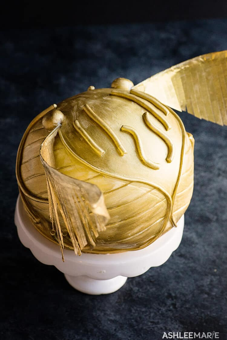 Light shining on golden snitch cake