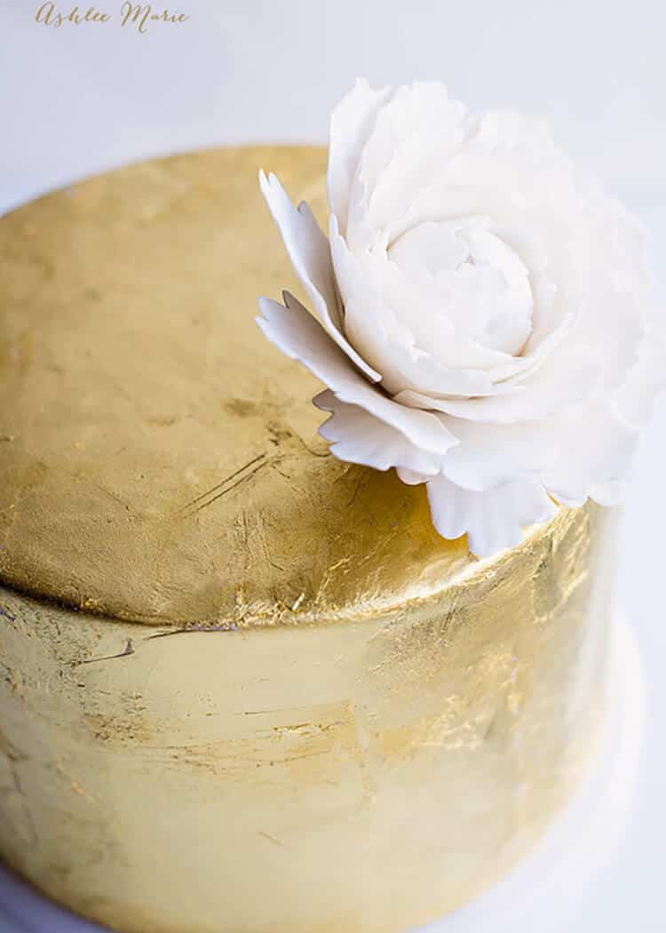 a video tutorial for gold leafing a cake - super easy and so impressively lovely
