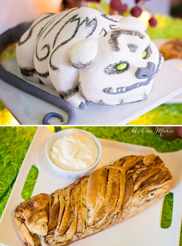 a carved Disney neverbeast cake with a cinnamon roll twist braid for Disneys Tinker Bell movie party