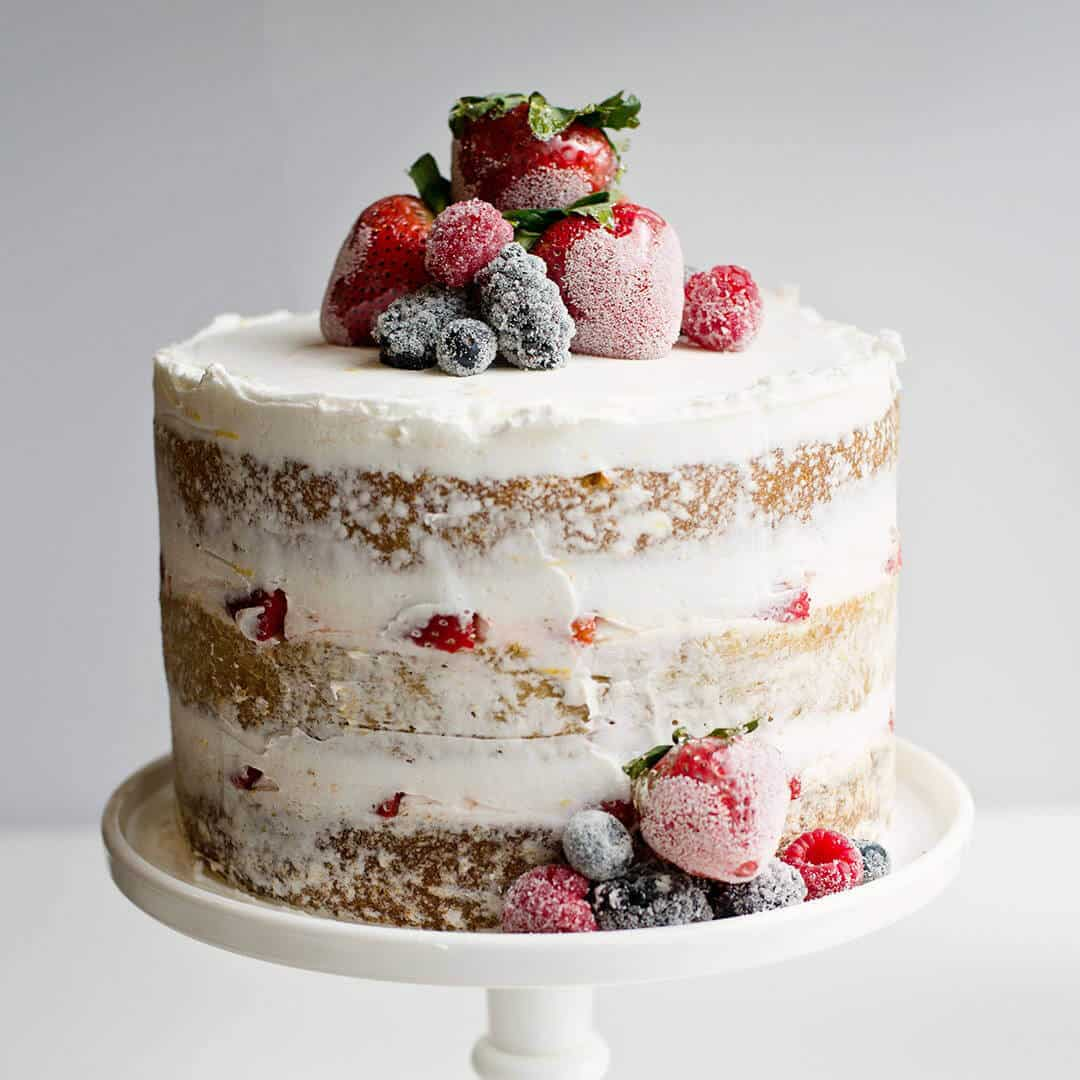 Vanilla bean cake, lemon buttercream with candied and sugared berries makes for a gorgeous cake