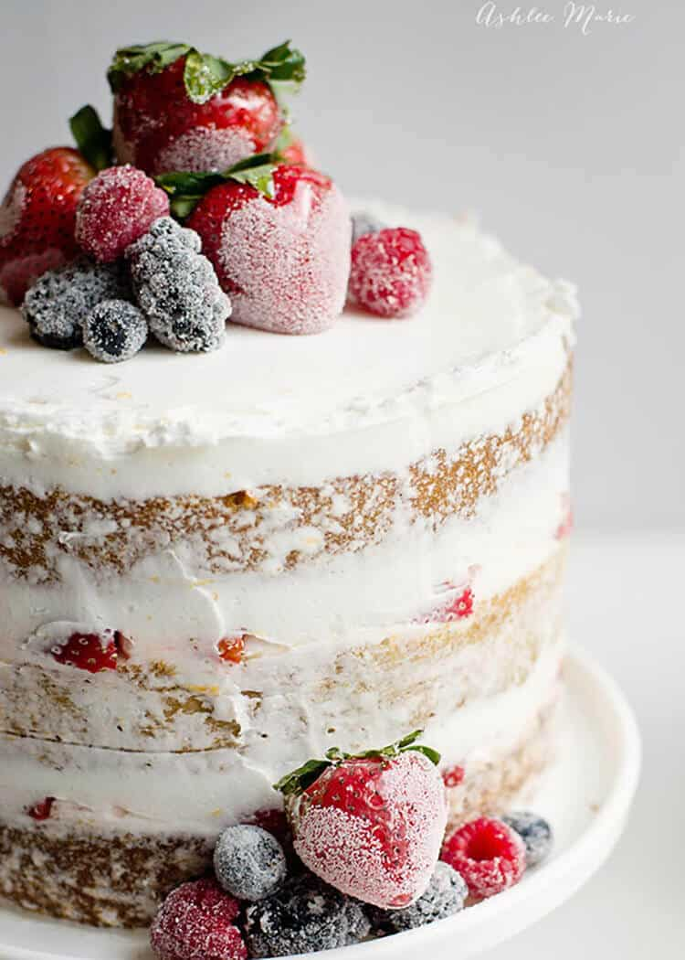 Naked cake with candied and sugared berries ashlee marie - How to slice strawberries for decoration ...