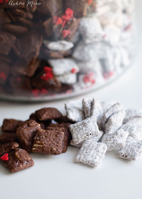 puppy chow is chocolate and peanut butter deliciousness covered in powdered sugar or brownie mix to create the black and white coloring