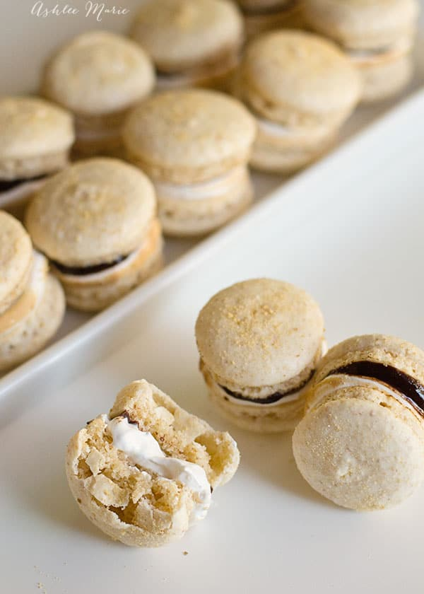 it doesnt get much better than smore macarons, graham cracker flavored macaron shells filled with chocolate ganache and marshmallow frosting