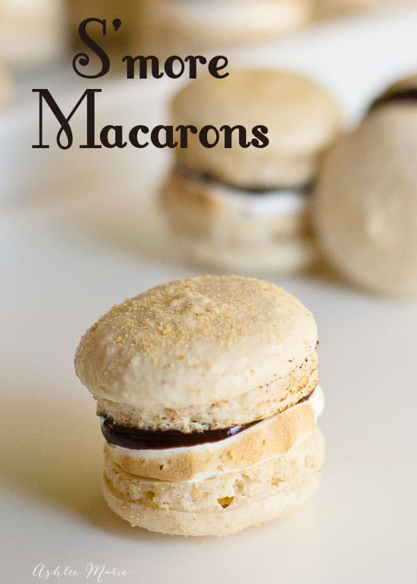 graham cracker flavored Macaron shells filled with chocolate ganache and marshmallow frosting for the perfect Smore macaron recipe, toast with a brulee torch for that extra touch