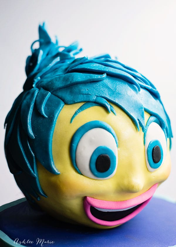 this joy cake has her signature crazy blue hair, a slight blush and a huge smile - video tutorial