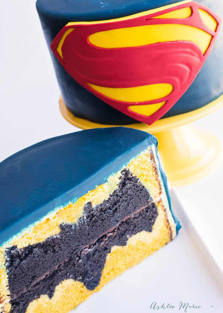 surprise your guests with a simple superman cake that holds a surprise inside, the batman logo inside the cake