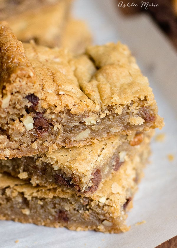 mini chocolate chips and chopped pecans taste amazing in these blondies
