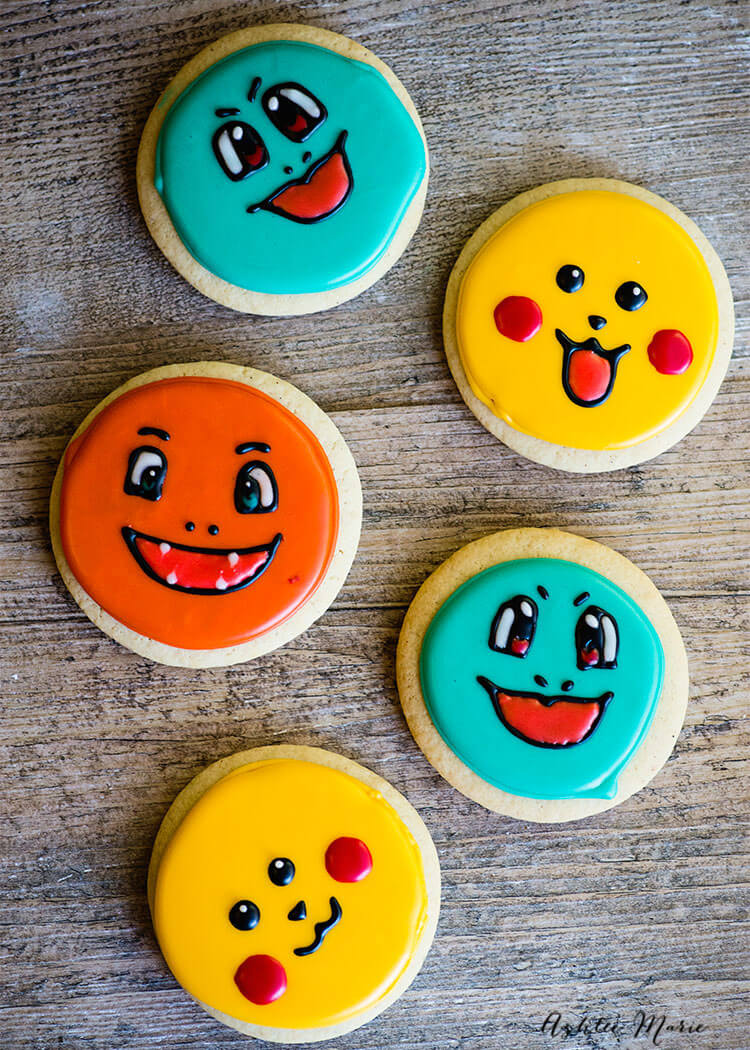 Video tutorials for these sweet Pokemon Sugar Cookies - Pikachu, Charmander and Squirtle | Ashlee Marie | Cookies | Pokemon | Sugar Cookies | Party Food | #ashleemarie #cookies #sugarcookies #pokemon #partyfood