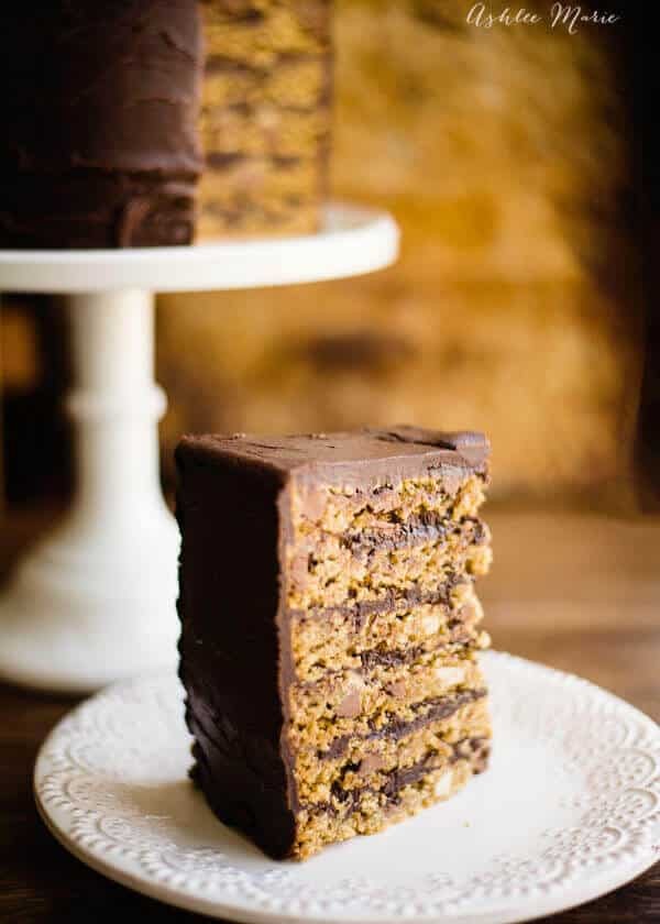 chocolate chip and macadamia nut cookie cake frosting in a rich dark choclate ganache a delicious dessert
