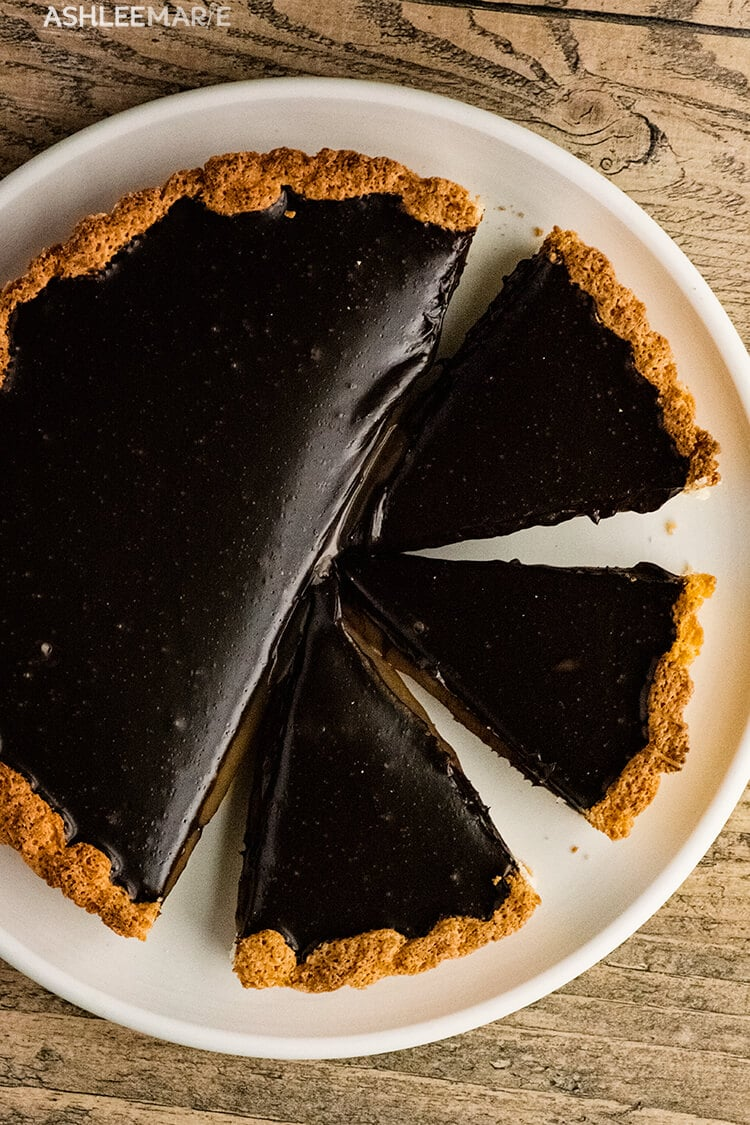 caramel coconut macaroon tart with chocolate ganache topping