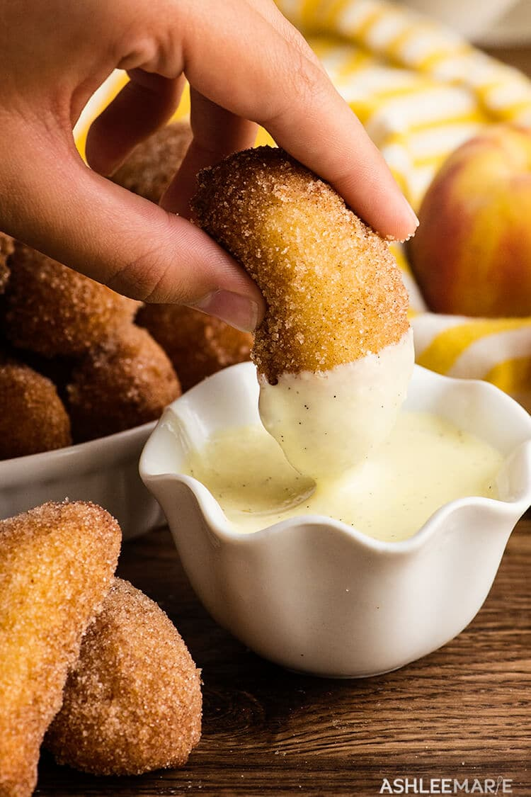 deep fried peaches with vanilla bean creme anglaise sauce. recipe and video | Ashlee Marie | Summer | Peaches | Vanilla Bean Sauce #ashleemarie #dessert #friedfood #fairfood #peaches